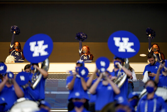 Kentucky cheerleaders cheer from the mezzanine level of Kroger Field during the second half of an NCAA college football game against Mississippi, Saturday, Oct. 3, 2020, in Lexington, Ky. (AP Photo/Bryan Woolston)