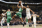 Indiana Pacers forward T.J. Warren (1) battles for a rebound with Boston Celtics guard Romeo Langford (45) during the second half of an NBA basketball game in Indianapolis, Tuesday, March 10, 2020. The Celtics won 114-111. (AP Photo/AJ Mast)
