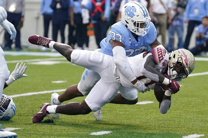 North Carolina linebacker Cedric Gray (33) tackles Florida State running back Jashaun Corbin (0) during the second half of an NCAA college football game in Chapel Hill, N.C., Saturday, Oct. 9, 2021. (AP Photo/Gerry Broome)