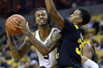 Missouri's Mitchell Smith, left, fights his way to the basket past Northern Kentucky's Dantez Walton during the second half of an NCAA college basketball game Friday, Nov. 8, 2019, in Columbia, Mo. Missouri won 71-56. (AP Photo/Jeff Roberson)