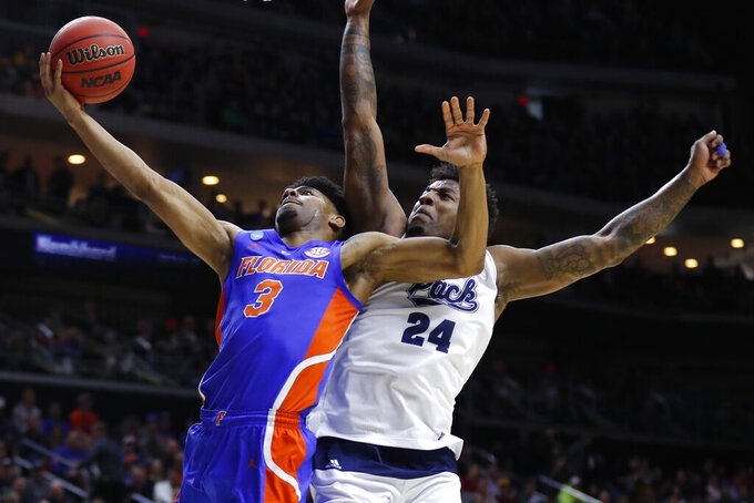 Florida guard Jalen Hudson (3) drives to the basket past Nevada forward Jordan Caroline during a first round men's college basketball game in the NCAA Tournament, Thursday, March 21, 2019, in Des Moines, Iowa. (AP Photo/Charlie Neibergall)