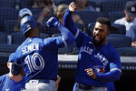 Toronto Blue Jays' Teoscar Hernandez congratulates Marcus Semien (10) on his grand slam against the New York Yankees during the ninth inning of a baseball game on Monday, Sept. 6, 2021, in New York. (AP Photo/Adam Hunger)