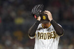 San Diego Padres starting pitcher Blake Snell adjusts his hat as he works against a Los Angeles Angels batter during the sixth inning of a baseball game Tuesday, Sept. 7, 2021, in San Diego. (AP Photo/Gregory Bull)