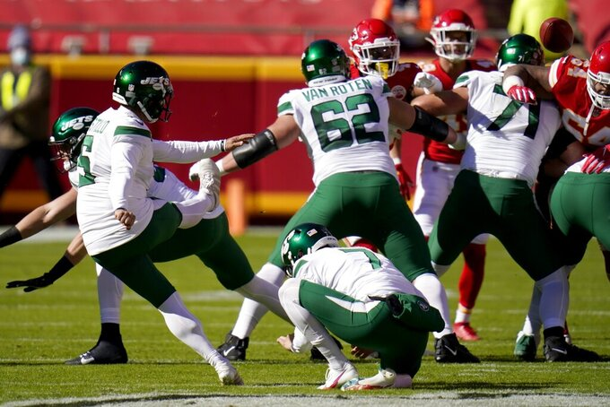 New York Jets place kicker Sergio Castillo (6) kicks a field goal as punter Braden Mann (7) holds in the first half of an NFL football game against the Kansas City Chiefs on Sunday, Nov. 1, 2020, in Kansas City, Mo. (AP Photo/Jeff Roberson)