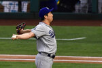 Los Angeles Dodgers starting pitcher Kenta Maeda gets set to pitch during the first inning of the team's baseball game against the Los Angeles Angels on Tuesday, June 11, 2019, in Anaheim, Calif. (AP Photo/Mark J. Terrill)