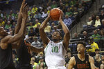 Oregon's Shakur Juiston, center, goes up for a shot against Southern California's Onyeka Okongwu, left, Ethan Anderson and Isaiah Mobley, right, during the first half of an NCAA basketball game in Eugene, Ore., Thursday, Jan. 23, 2020. (AP Photo/Chris Pietsch)
