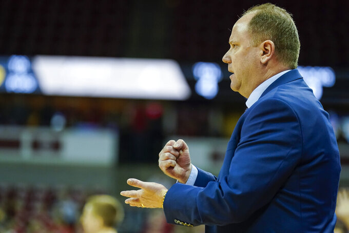 Wisconsin head coach Greg Gard yells to his team during the first half of an NCAA college basketball game against Purdue Tuesday, Feb. 18, 2020, in Madison, Wis. (AP Photo/Andy Manis)
