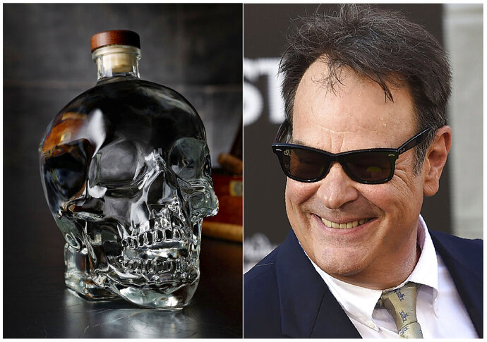 This combination photo shows actor and businessman Dan Aykroyd at the Los Angeles premiere of