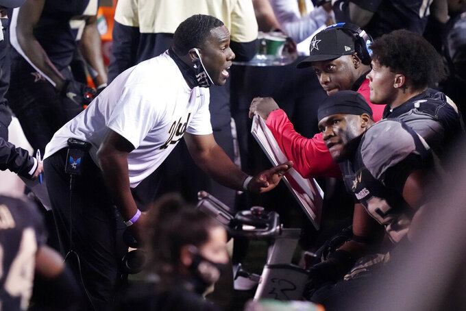Vanderbilt head coach Derek Mason talks to his players in the second half of an NCAA college football game against LSU Saturday, Oct. 3, 2020, in Nashville, Tenn. LSU won 41-7. (AP Photo/Mark Humphrey)
