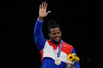 Cuba's Reineris Salas Perez waves as hi stands on the podium with his bronze medal during the victory ceremony for men's freestyle 97kg wrestling at the 2020 Summer Olympics, Saturday, Aug. 7, 2021, in Chiba, Japan. (AP Photo/Aaron Favila)