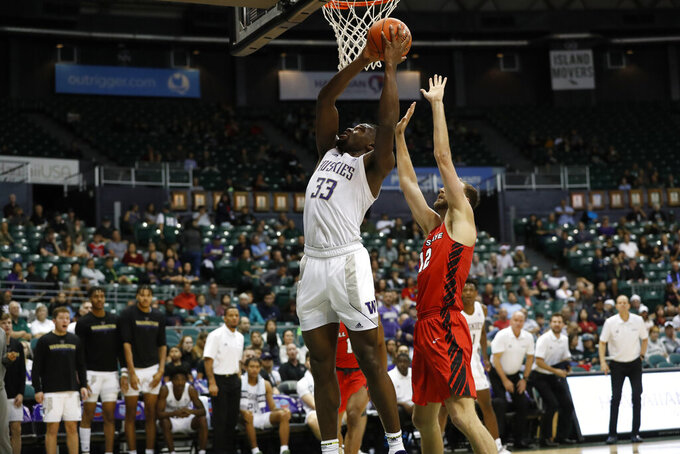 Washington forward Isaiah Stewart (33) grabs a rebound over Ball State forward Brachen Hazen (12) during the second half of an NCAA college basketball game, Sunday, Dec. 22, 2019, in Honolulu. (AP Photo/Marco Garcia)