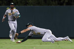Oakland Athletics right fielder Chad Pinder can't catch a fly ball hit by Los Angeles Angels' Jared Walsh during the seventh inning of a baseball game in Anaheim, Calif., Saturday, Sept. 18, 2021. (AP Photo/Alex Gallardo)