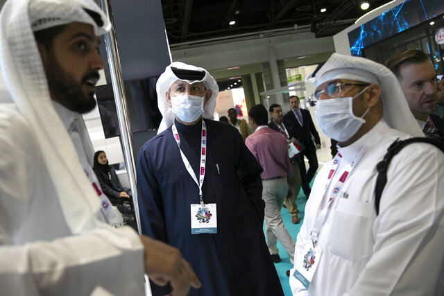 Visitors and exhibitors wear masks at the Arab Health Exhibition in Dubai, United Arab Emirates, Wednesday, Jan. 29, 2020. The United Arab Emirates on Wednesday confirmed the first cases in the Mideast of the new Chinese virus that causes flu-like symptoms, saying doctors now were treating a family that had just come from a city at the epicenter of the outbreak. (AP Photo/Kamran Jebreili)
