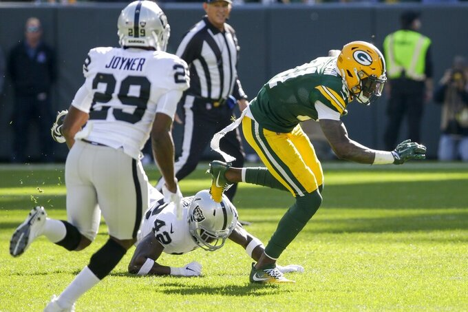 Green Bay Packers' Geronimo Allison catches a pass during the first half of an NFL football game against the Oakland Raiders Sunday, Oct. 20, 2019, in Green Bay, Wis. (AP Photo/Mike Roemer)