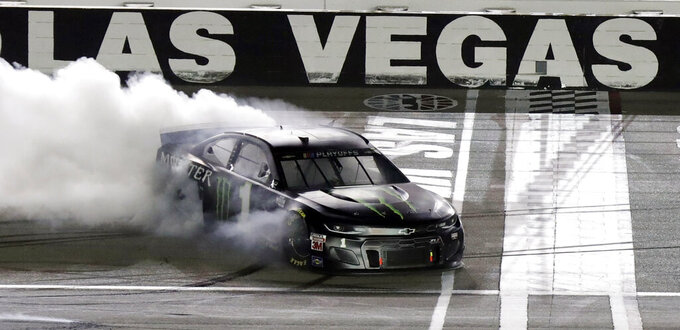 Kurt Busch performs a burnout after winning a NASCAR Cup Series auto race, Sunday, Sept. 27, 2020, in Las Vegas. (AP Photo/Isaac Brekken)