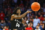 Long Beach State guard Colin Slater passes the ball in the first half during an NCAA college basketball game against Arizona, Sunday, Nov. 24, 2019, in Tucson, Ariz. (AP Photo/Rick Scuteri)
