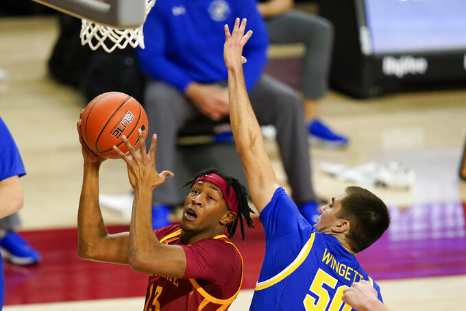 Iowa State forward Javan Johnson, left, drives to the basket past South Dakota State guard David Wingett (50) during the first half of an NCAA college basketball game, Wednesday, Dec. 2, 2020, in Ames, Iowa. (AP Photo/Charlie Neibergall)