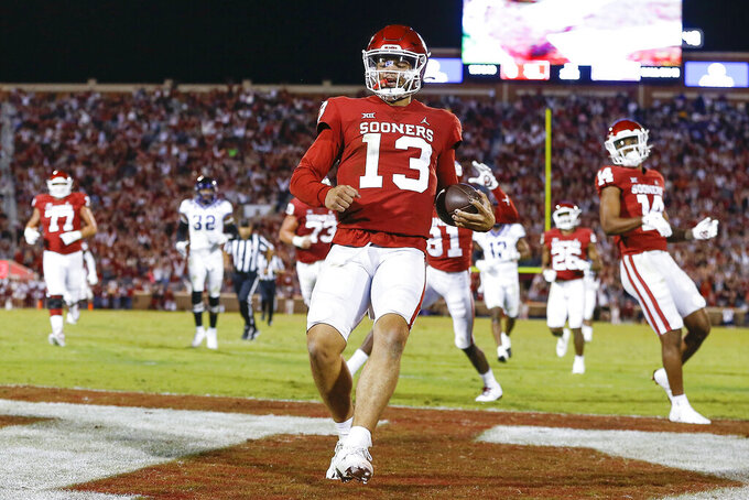 Oklahoma quarterback Caleb Williams (13) runs in for a touchdown during the second half of an NCAA college football game against TCU, Saturday, Oct. 16, 2021, in Norman, Okla. (AP Photo/Alonzo Adams)