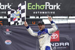 Todd Gilliland celebrates in Victory Lane after winning the NASCAR Truck Series auto race at the Circuit of the Americas in Austin, Texas, Saturday, May 22, 2021. (AP Photo/Chuck Burton)