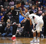 Cincinnati's Justin Jenifer reaches out to Connecticut's Alterique Gilbert (3) after Gilbert missed a shot at the end of an NCAA college basketball game, Sunday, Feb. 24, 2019, in Hartford, Conn. (AP Photo/Jessica Hill)