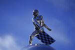 The top of the Borg-Warner Trophy complete with checkered flag mask, is shown on the start/finish line before the final practice session for the Indianapolis 500 auto race at Indianapolis Motor Speedway, Friday, Aug. 21, 2020, in Indianapolis. (AP Photo/Darron Cummings)
