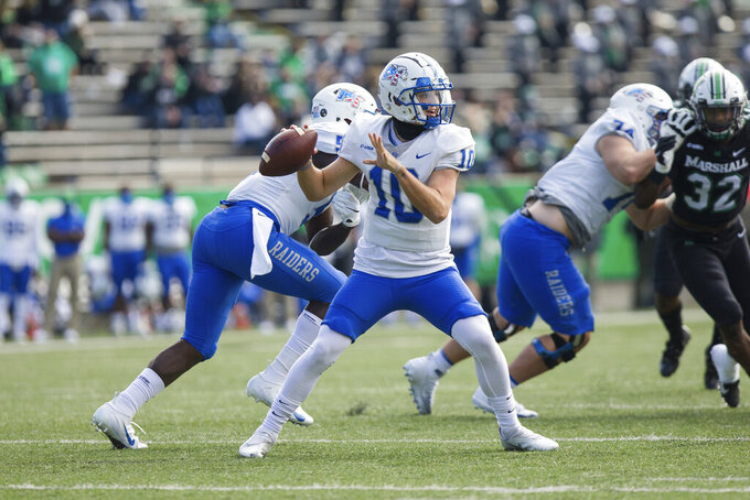 Middle Tennessee quarterback Asher O'Hara (10) looks for a receiver during the team's NCAA college football game against Marshall on Saturday, Nov. 14, 2020, in Huntington, W.Va. (Sholten Singer/The Herald-Dispatch via AP)