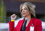 FILE - In this Nov. 18, 2020, file photo, Dr. Kelli Ward, chair of the Arizona Republican Party, holds a press conference in Phoenix. Arizona Republicans voted Saturday, Jan. 23, 2021, to censure Cindy McCain and two prominent GOP officials who have found themselves crosswise with former President Donald Trump. Party activists also reelected controversial Chairwoman Kelli Ward, who has been one of Trump's most unflinching supporters and among the most prolific promoters of his baseless allegations of election fraud. (AP Photo/Ross D. Franklin, File)