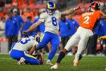 Los Angeles Rams kicker Matt Gay (8) kicks a field goal as punter Corey Bojorquez (13) holds during the first half of an NFL preseason football game against the Denver Broncos, Saturday, Aug. 28, 2021, in Denver. (AP Photo/Jack Dempsey)