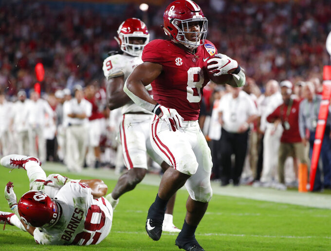Alabama running back Josh Jacobs (8) runs for a touchdown, during the first half of the Orange Bowl NCAA college football game against Oklahoma, Saturday, Dec. 29, 2018, in Miami Gardens, Fla. (AP Photo/Wilfredo Lee)