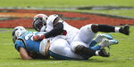 Tampa Bay Buccaneers linebacker Devin White (45) takes down Carolina Panthers running back Christian McCaffrey (22) during the second half of an NFL football game Sunday, Sept. 20, 2020, in Tampa, Fla. (AP Photo/Jason Behnken)