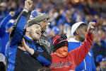 Kyle Wathen, left, and his father-in-law, John Arnold, right, cheer and jeer during the first half of the NCAA college football game between Louisville and Kentucky in Louisville, Ky., Saturday, Nov. 24, 2018. (AP Photo/Bryan Woolston)