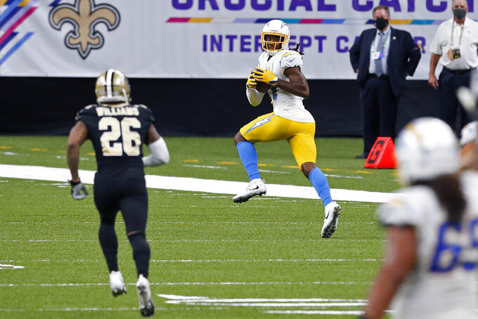 Los Angeles Chargers wide receiver Mike Williams (81) pulls in a 64 yard touchdown reception in the second half of an NFL football game against the New Orleans Saints in New Orleans, Monday, Oct. 12, 2020. (AP Photo/Butch Dill)