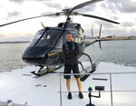 This undated photo provided by Group 3 Aviation shows helicopter pilot Ara Zobayan, who was at the controls of the helicopter that crashed in Southern California, Sunday, Jan. 26, 2020, killing all nine aboard including former Lakers star Kobe Bryant. Location is not provided. (Group 3 Aviation via AP)