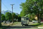 With Mount Sopris in the background, Alex Eherenman drives his camper to work for the day on July 1, 2021 in Carbondale, Colo.  Eherenman has lived in his truck-bed camper on and off since 2017 trying to make enough at his jobs while trying to save money so he can afford either a security deposit for an apartment or the down payment on an apartment come winter time.  (Helen H. Richardson /The Denver Post via AP)