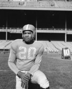 FILE - In this Nov. 2, 1950, file photo, New York Yanks football player George Taliaferro (20) poses in New York. Taliaferro, a standout running back for Indiana who became the first black player to be drafted by an NFL team when George Halas and the Chicago Bears took him in the 13th round of the NFL draft, has died. He was 91. Senior associate athletic director Jeremy Gray said Tuesday, oct. 9, 2018, the Hoosiers had spoken with Taliaferro's family about his death in Mason, Ohio.  (AP Photo/Murray Becker)