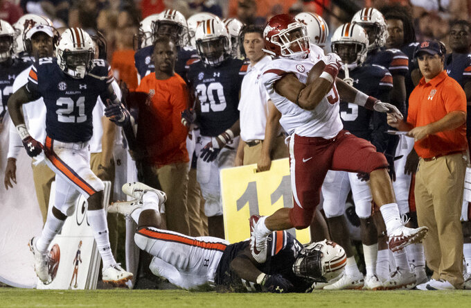FILE - In this Sept. 22, 2018, file photo, Arkansas running back Rakeem Boyd (5) breaks free from Auburn defensive back Smoke Monday (21) and linebacker Deshaun Davis (57) during the second half of an NCAA college football game, in Auburn, Ala. The running back has lived up to his lofty expectations this season for the Razorbacks, who need to keep Boyd healthy and on the field to have a chance at their first SEC win this week against Vanderbilt. (AP Photo/Vasha Hunt, File)