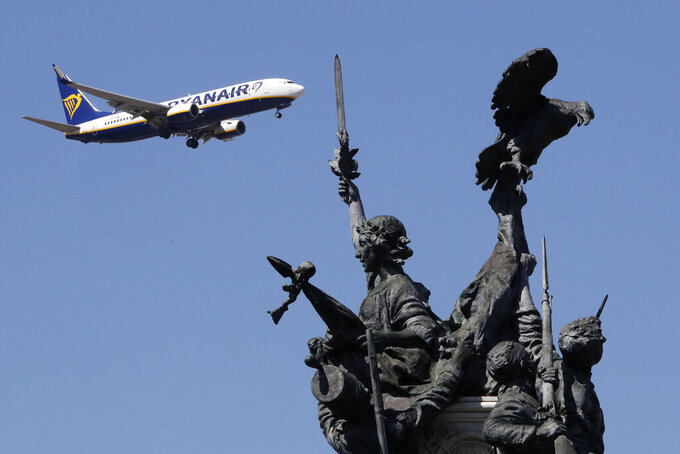 FILE - In this Wednesday, Aug. 21, 2019 file photo, a Ryanair airplane approaching landing at Lisbon airport flies past the Monument to the Heroes of the Peninsular War, in the foreground. A top European Union court dealt another blow to Ryanair on Wednesday, April 14, 2021 and rejected the low-cost carrier's arguments that the aid Sweden, Denmark and Finland gave two other airlines to get through the COVID-19 crisis was illegal. (AP Photo/Armando Franca, File)