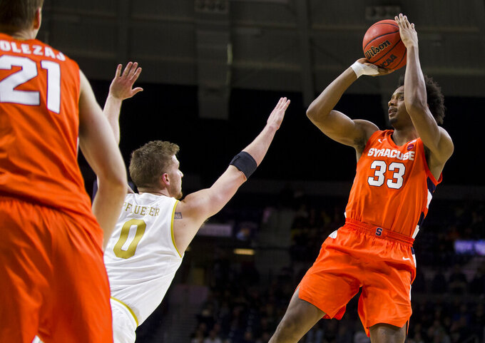 Syracuse's Elijah Hughes (33) shoots over Notre Dame's Rex Pflueger (0) during the second half of an NCAA college basketball game Wednesday, Jan. 22, 2020, in South Bend, Ind. Syracuse won 84-82. (AP Photo/Robert Franklin)