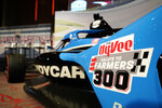A Salute to Farmers 300 logo is seen on a car during a news conference at Hy-Vee Corp. headquarters, Thursday, Aug. 19, 2021, in West Des Moines, Iowa. IndyCar will return next season to Iowa Speedway, a short oval track beloved by fans and drivers that had fallen off the schedule after 14 years. The track located in Newton will host a doubleheader next July in a deal brokered between IndyCar Series owner Roger Penske, team owner Bobby Rahal and grocery chain Hy-Vee. (AP Photo/Charlie Neibergall)