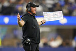 Las Vegas Raiders coach Jon Gruden argues a call during the second half of the teams' preseason NFL football game against the Los Angeles Rams on Saturday, Aug. 21, 2021, in Inglewood, Calif. (AP Photo/Ashley Landis)