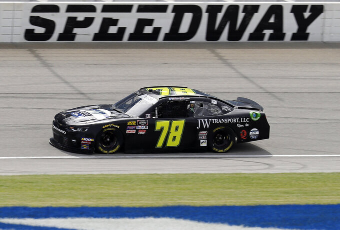 Vinnie Miller drives on the track during a NASCAR Xfinity Series auto race practice at Chicagoland Speedway in Joliet, Ill., Friday, June 28, 2019. (AP Photo/Nam Y. Huh)