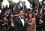 Actors Javier Bardem, left, and Charlotte Gainsbourg pose for photographers upon arrival at the opening ceremony and the premiere of the film 'The Dead Don't Die' at the 72nd international film festival, Cannes, southern France, Tuesday, May 14, 2019. (AP Photo/Petros Giannakouris)