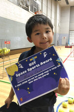 In this 2016 photo released by Lucius Chiu, Alaric Chiu holds a school certificate in Tokyo. Alaric was 5 years old in 2019 when he died during a kayaking trip. The Hawaii private school Mid-Pacific Institute that coordinated the spring break program and his family have a settled a lawsuit over the boy's drowning for $7.2 million. (Lucius Chiu via AP)