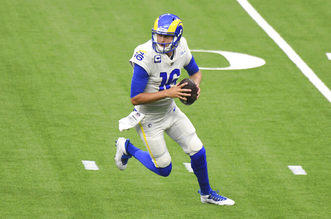 Quarterback Jared Goff (16) of the Los Angeles Rams prepares to pass against the Dallas Cowboys in the first half of a NFL football game on opening night at SoFi Stadium in Inglewood on Sunday, September 13, 2020. (Keith Birmingham/The Orange County Register via AP)