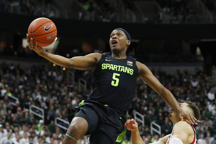 Michigan State guard Cassius Winston (5) makes a layup during the second half of an NCAA college basketball game against Wisconsin, Friday, Jan. 17, 2020, in East Lansing, Mich. (AP Photo/Carlos Osorio)
