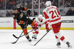 Anaheim Ducks center Ryan Getzlaf shoots past Detroit Red Wings center Christoffer Ehn and defenseman Dennis Cholowski during the second period of an NHL hockey game in Anaheim, Calif., Tuesday, Nov. 12, 2019. (AP Photo/Chris Carlson)