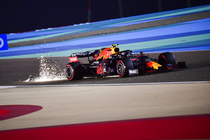 Red Bull driver Max Verstappen of the Netherlands steers his car during the qualifying session at the Formula One Bahrain International Circuit in Sakhir, Bahrain, Saturday, Nov. 28, 2020. (Giuseppe Cacace, Pool via AP)