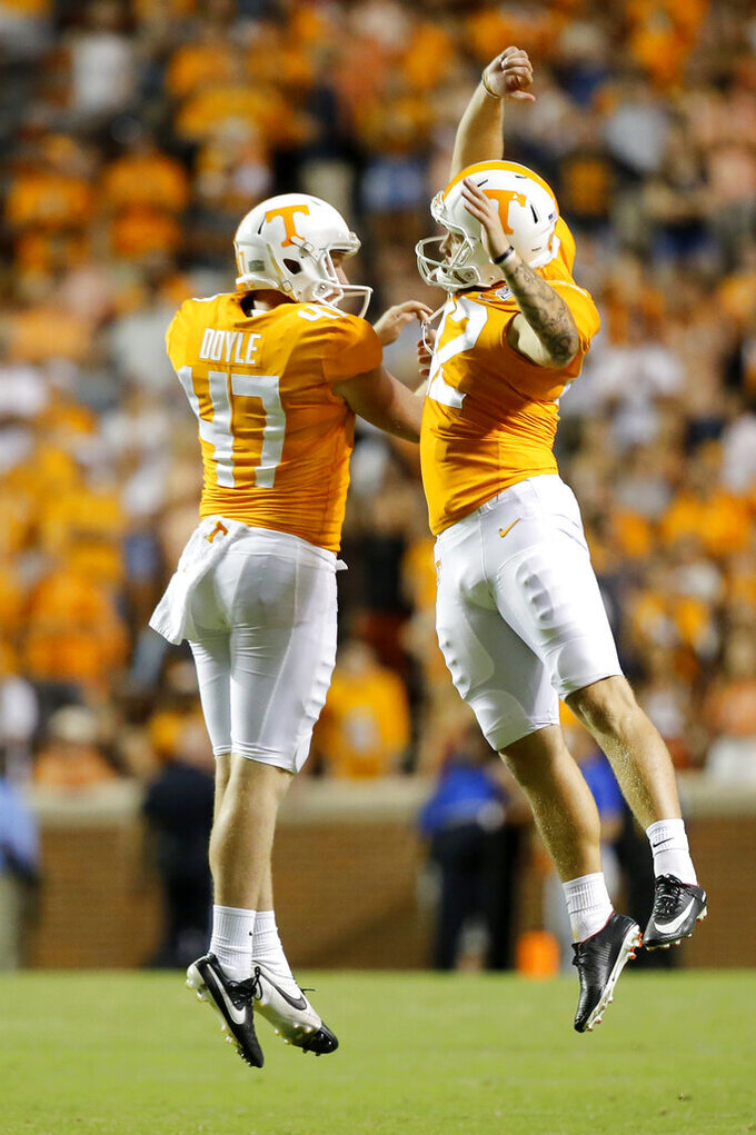 Tennessee punter Joe Doyle (47) and kicker Brent Cimaglia (42) celebrate after a 52-yard punt against BYU during a NCAA football game at Neyland Stadium on Saturday, Sept. 7, 2019 in Knoxville, Tenn.(C.B. Schmelter/Chattanooga Times Free Press via AP)