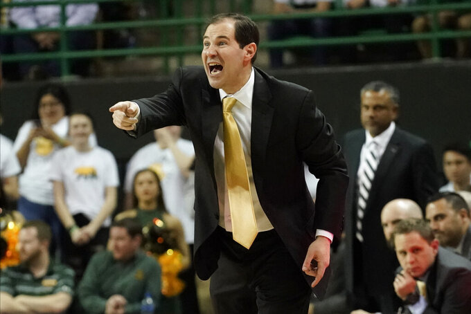 Baylor head coach Scott Drew directs his team against Texas Tech during the second half of an NCAA college basketball game in Waco, Texas, Monday, March 2, 2020. Baylor's prospects for this season improved exponentially when top scorers Jared Butler (16.0 points per game) and senior guard MaCio Teague (13.9 ppg) both decided to return after considering early entry in the NBA draft. (AP Photo/Chuck Burton)