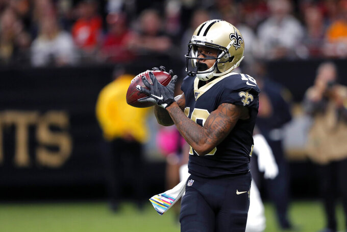 New Orleans Saints wide receiver Ted Ginn (19) pulls in a touchdown reception uncovered in the second half of an NFL football game against the Tampa Bay Buccaneers in New Orleans, Sunday, Oct. 6, 2019. (AP Photo/Bill Feig)
